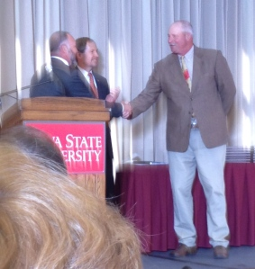 Ruble receiving an animal science award at Iowa State University