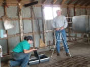 William setting up equipment used to study temperament in beef cattle.